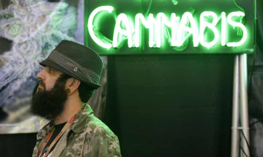 The owner of a marijuana seed company at CannaCon, a marijuana business trade show in Seattle. Washington state legalised cannabis in 2012.