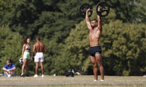 A man exercises in Hyde Park in London