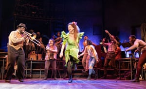 Nathaniel Cross, on trombone, and Amber Gray, centre, in Hadestown.