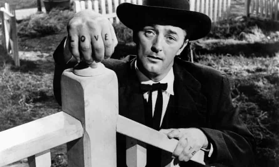 Robert Mitchum as Harry Powell in the film version of The Night of the Hunter.