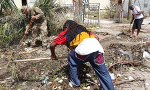British army commandos and local residents take part in recovery efforts after Hurricane Irma passed Tortola, in the British Virgin Islands.