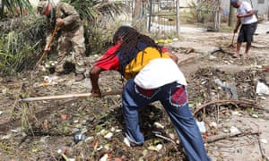 Residents work to clear debris on Tortola in the British Virgin Islands, aided by British soldiers.­­­