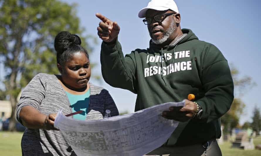 Kristi Williams, left, and Chief Egunwale Amusan view a cemetery map during a search for possible mass burial graves from Tulsa's 1921 Race Massacre at Oaklawn Cemetery in Tulsa in October 2019.