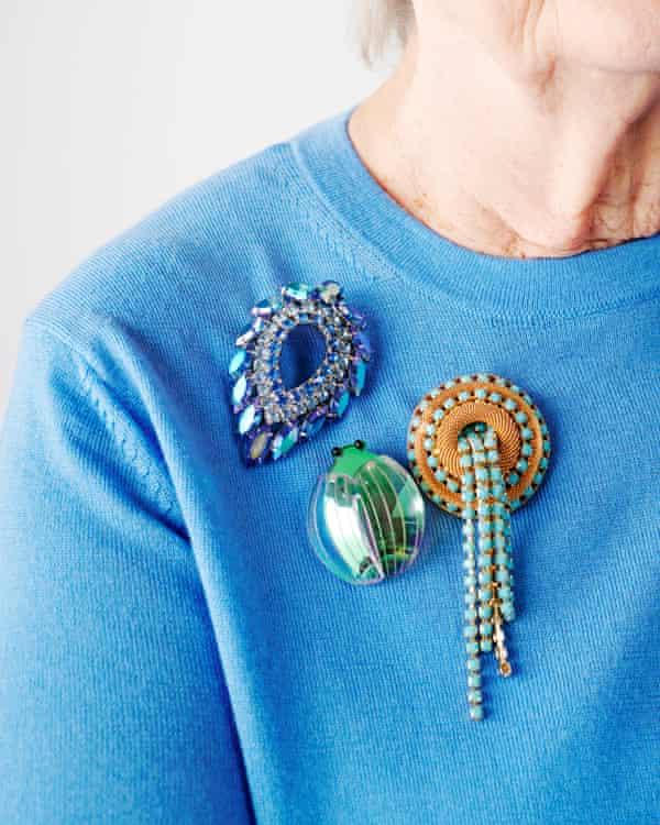 Beetle brooch, £35, tattydevine.com. Vintage leaf and turquoise/gold tassel brooches, both susancaplan.co.uk. Knit, £29.50, marksandspencer.com.