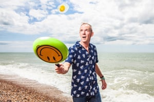 DJ Norman Cook flips an egg on the beach in Brighton