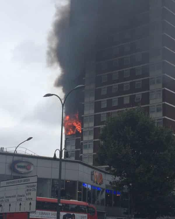 Flames on the exterior of a Shepherd's Bush block of flats, where a tumble dryer allegedly started a fire.
