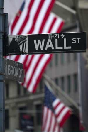 NEW YORK - FEBRUARY 04: A street sign reads Wall Street in front of the New York Stock Exchange on February 4, 2013 in New York City. Stocks dropped sharply today following the Dow's close last week above 14000.(Photo by Michael Nagle/Getty Images)