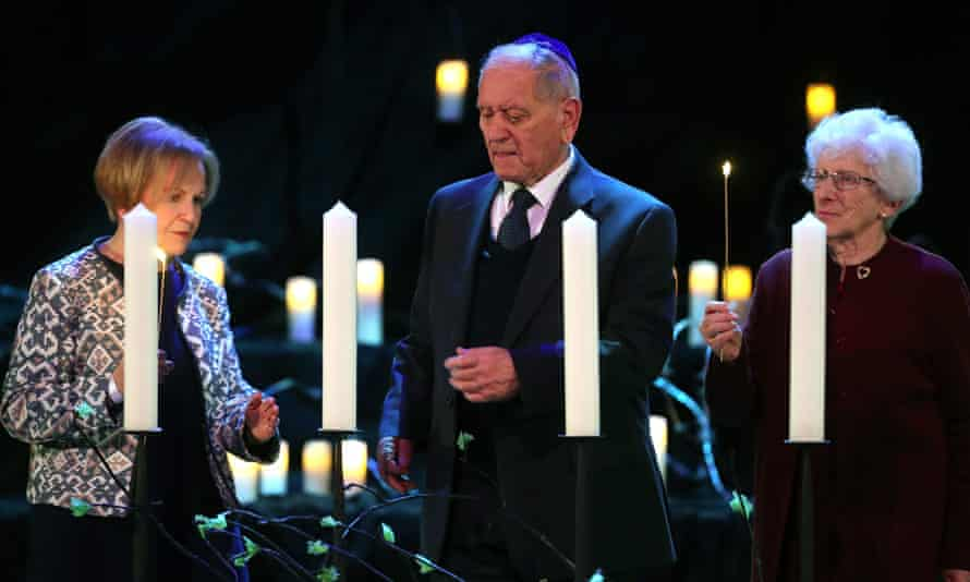Holocaust survivors light candles at the Holocaust Memorial Day event in Westminster.
