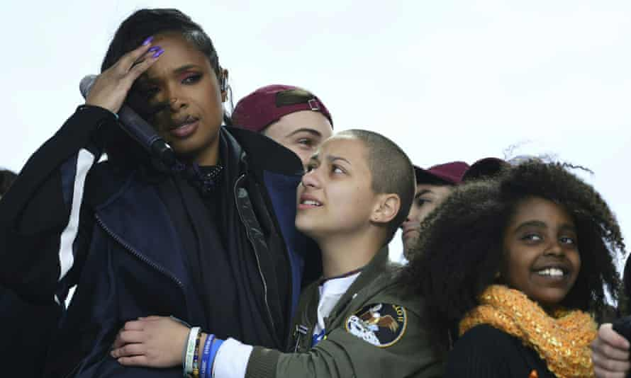 The actress Jennifer Hudson is embraced by Emma González, a survivor of the high school shooting in Parkland, Florida