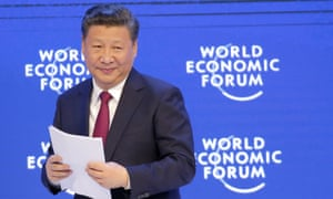 Xi Jinping smiles to the audience at Davos