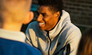 Marcus Rashford talking to children at his old primary school, Button Lane, in October.