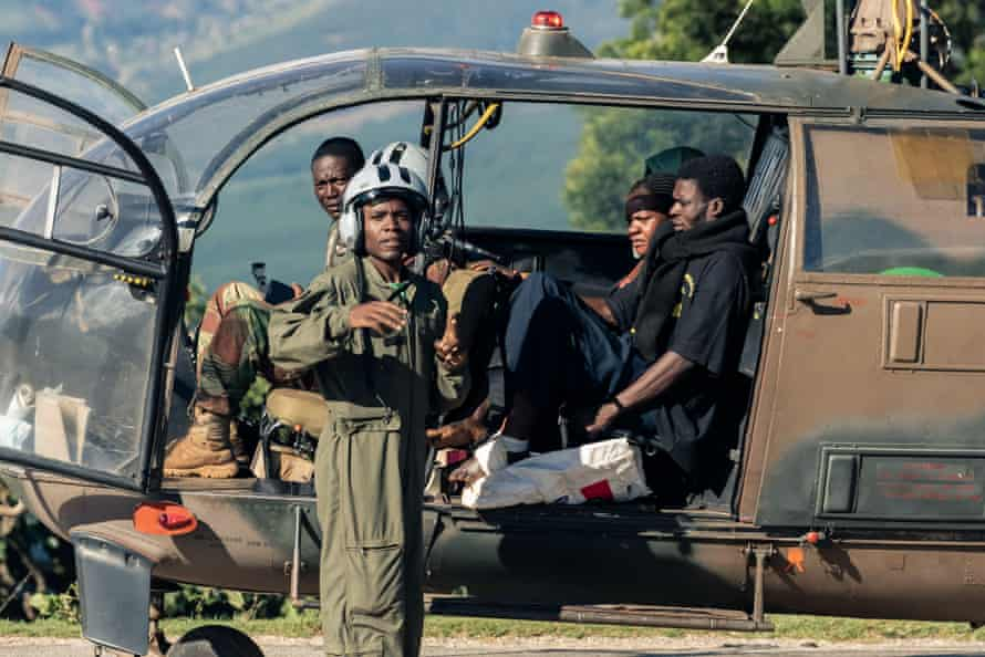 A man with an injured foot arrives at a temporary medical camp in Chimanimani after he was rescued by the Air Force of Zimbabwe.