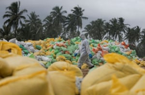 Ja-Ela, Sri Lanka A Sri Lankan navy officer walks past the sacks of collected debris washed up on a beach from the MV X-Press Pearl container ship, which caught fire and sunk off Colombo harbour