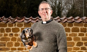Coles at the vicarage where he lives with his two dachshunds Daisy and Pongo.