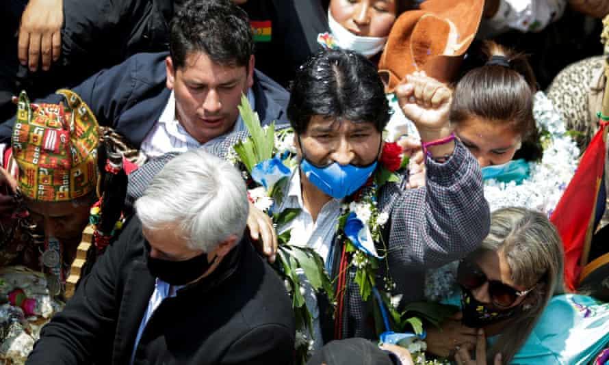 Evo Morales raises a fist as he returns at the border town of Villazón, Bolivia, on 9 November.