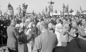 Alfa's Giuseppe Farina receives the trophy after winning the race.
