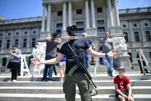 Armed protesters have become a familiar site at state capitols in recent weeks.