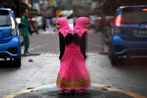 A girl leaves after Eid al-Fitr prayers at a mosque in Kuala Lumpur