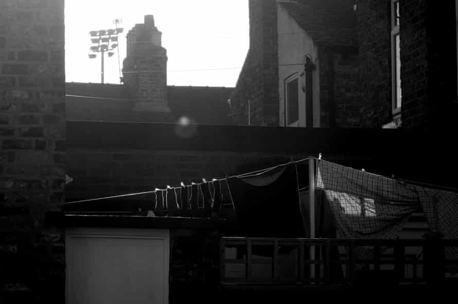 A floodlight at the ground peering over nearby houses