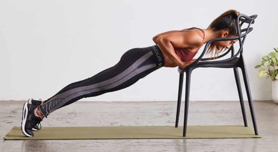 Shona Vertue doing tricep push-up with chair