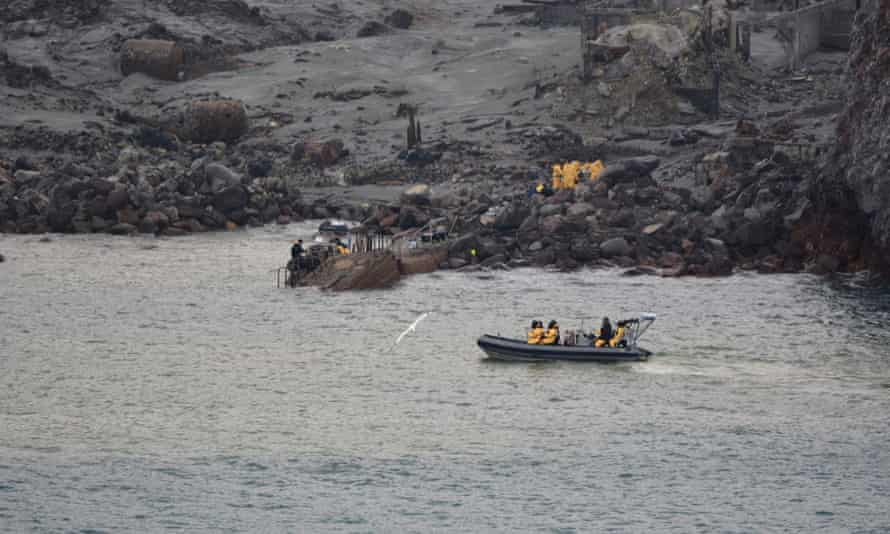 Police and navy divers search the sea off White island on Saturday.