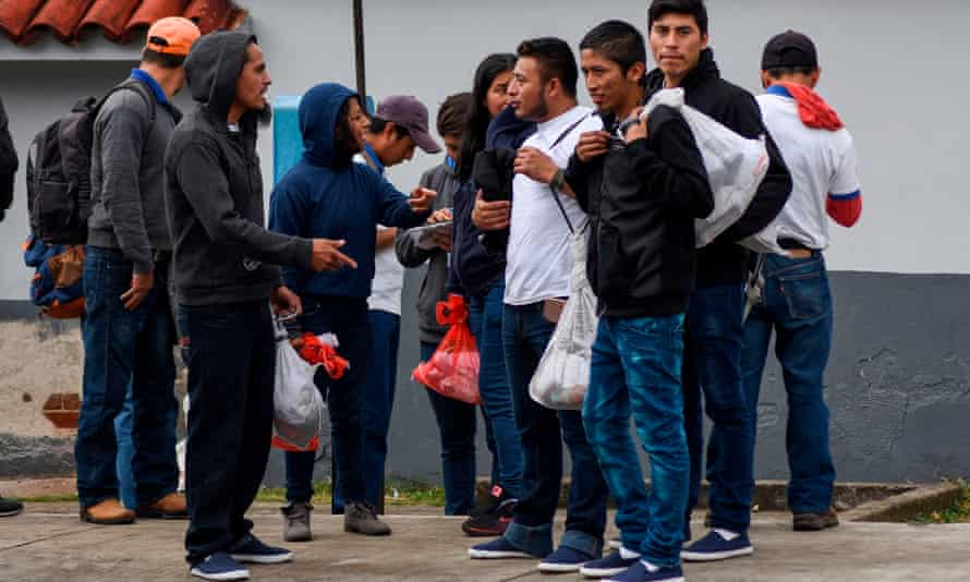 Migrants deported from the United States are seen outside the air force base upon their arrival in Guatemala City on 12 December 2019.
