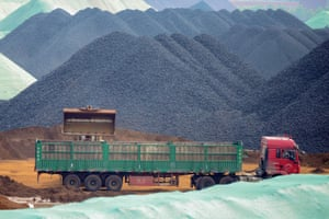 A truck transferring imported iron ore at a port in Rizhao in China's eastern Shandong province.