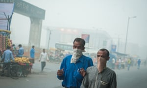 Two men with mouth covered with cloth in Delhi