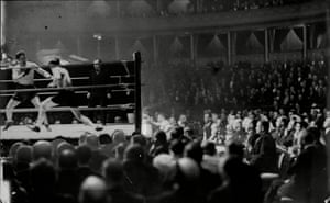 A packed house watch Don Mccorkindale take on Heine Muller in April 1932. Mccorkindale won on points.