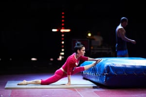 Performers stretch out before practising on the big top stage