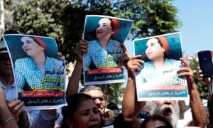 Moroccan activists with posters of Hajar Raissouni, a journalist charged with having sex before marriage and having an illegal abortion, during a protest outside the Rabat tribunal, Morocco, on 9 September.