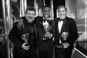 From left, Andy Serkis, who was rewarded for his outstanding contribution to cinema, Michael Ward, who won the EE Bafta rising star award, and best actor winner Joaquin Phoenix