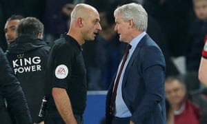 Mark Hughes speaks with referee Roger East after Tuesday's defeat at Leicester.