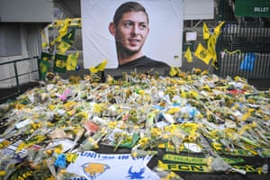 Yellow flowers are displayed in front of the portrait of Emiliano Sala at the Beaujoire stadium in Nantes.