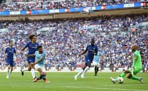 Aguero of Manchester City scores his side's second goal.