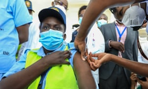 A health worker receives the Oxford AstraZeneca vaccine in Kenya