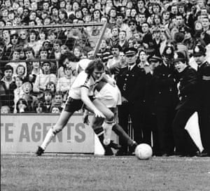 A policeman seems to be enjoying seeing David O'Leary and Chris Jones tussle during Arsenal's 2-1 win at White Hart Lane on 7 April 1980.