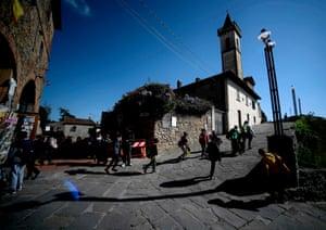 Visitors walk past the Santa Croce church