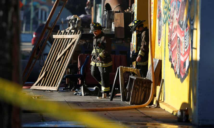 Firefighters leave the warehouse