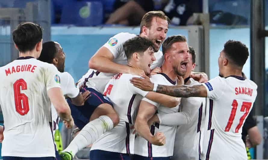 Jordan Henderson is mobbed after scoring England's fourth against Ukraine