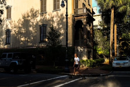 A man rides his skateboard around the Historic District in Savannah, Georgia, amid the novel coronavirus pandemic on April 25, 2020.