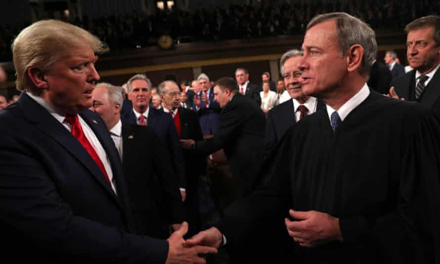 John Roberts with Donald Trump at the president's State of the Union speech in February. Roberts has been a critical justice in dismantling fundamental democratic protections.