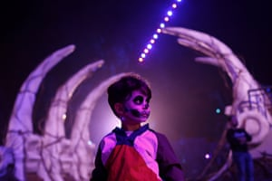 A child walks through the Calaverandia theme park, installed for the Day of the Dead celebrations, which are part of the Unesco intangible cultural heritage of humanity