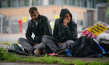 Two Afghan refugees protest outside the Home Office in Glasgow on 1 August.