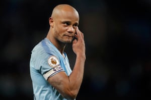 Kompany sheds tears on a lap of honour after his final home game at the Etihad Stadium.