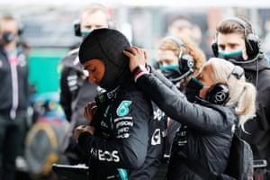Lewis Hamilton prepares to drive on the grid.