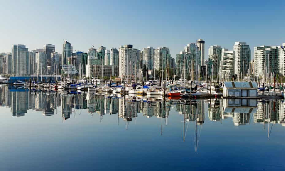 Buildings line Coal Harbour in Vancouver, where property prices rose by 39% in the year before a tax on overseas investors was implemented.