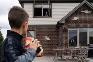 Karen Osdieck's children play football at her home in Illinois. Detailed caption TK.