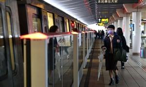 People wear protective masks on metro in Taipei, Taiwan
