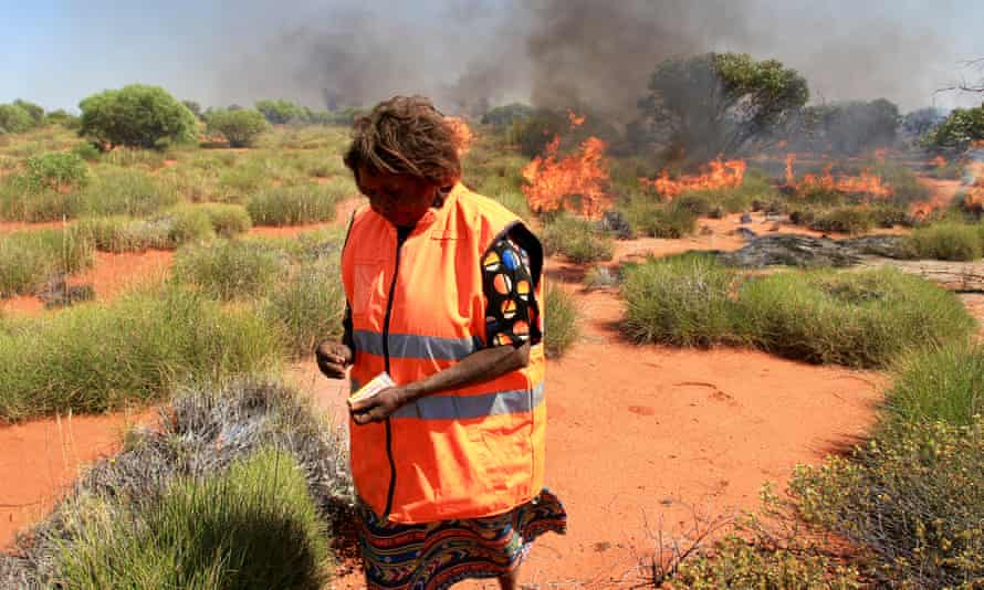 A traditional owner burning off in remote desert country